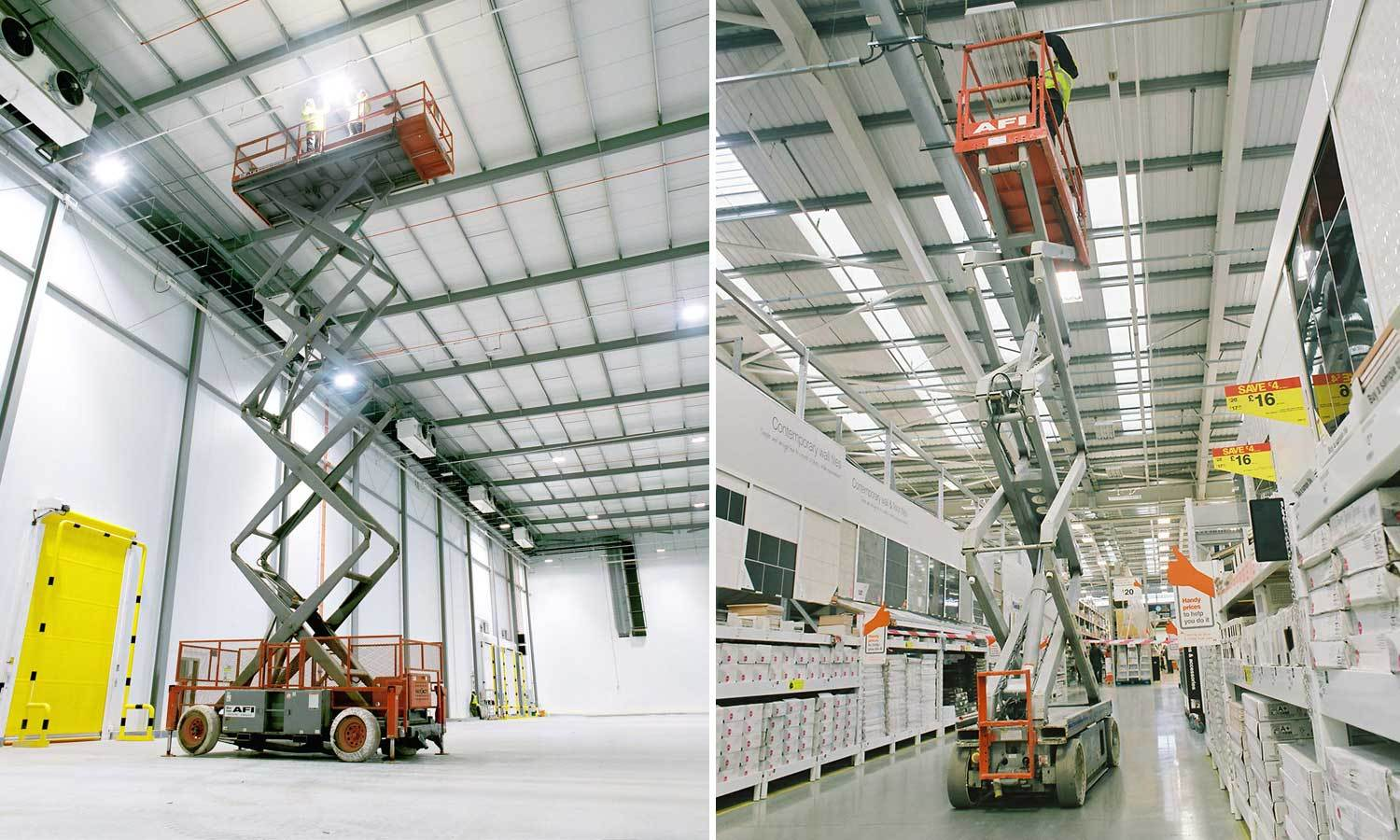 Scissor Lift With Operators Working At Height On Site