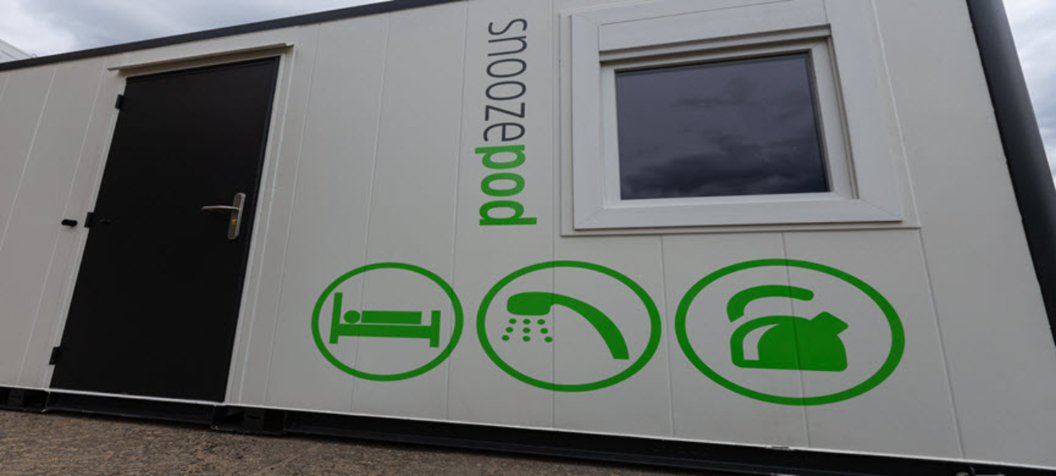 Close Up Of Nixon Hire Snoozepod Sleeper Cabin With Bedrooms, Bathroom and Kitchen