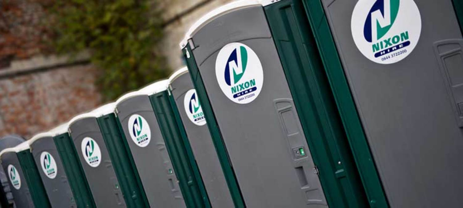 Close Up Of Nixon Hire Portable Toilets Waiting In Service Yard