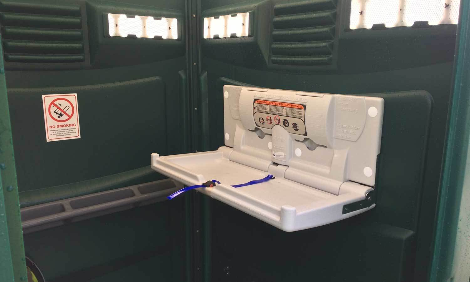 Interior Shot Of Baby Changing Unit Fitted In Wheelchair Access Portable Toilet Unit