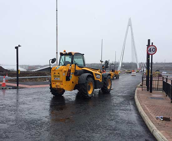 Nixon Hire telehandler and dumper on Northern Spire construction site